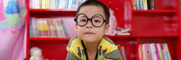 Child in class with glasses